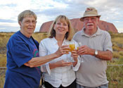Travelers Celebrating In Front of Ayers Rock, Australia